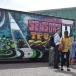 People waiting in front of the Sensory Truck